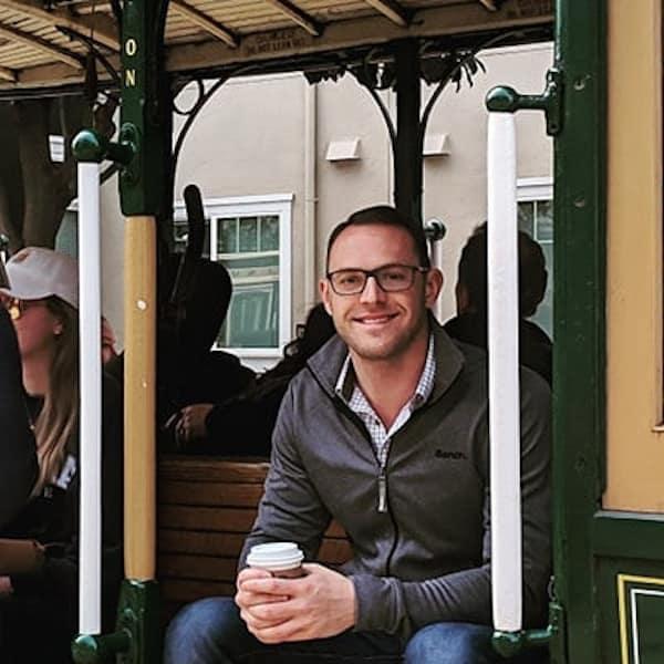 headshot of skylar on a streetcar